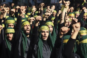 Lebanon's Hezbollah supporters gesture as they march during a ceremony to mark Ashura in Beirut's suburbs